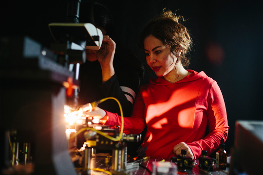 Female electrical engineering student in OPEN lab at GWU