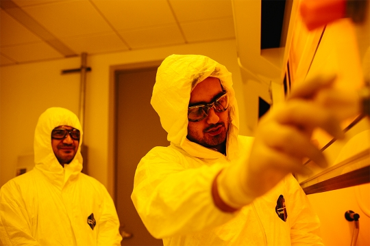 Students conducting experiments in the nanofabrication clean room of the Science and Engineering Hall.