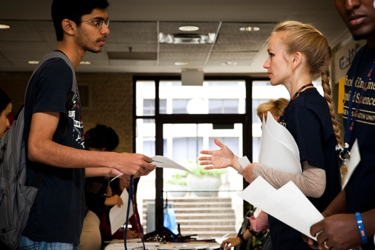 Student conversing with recruiter for more information