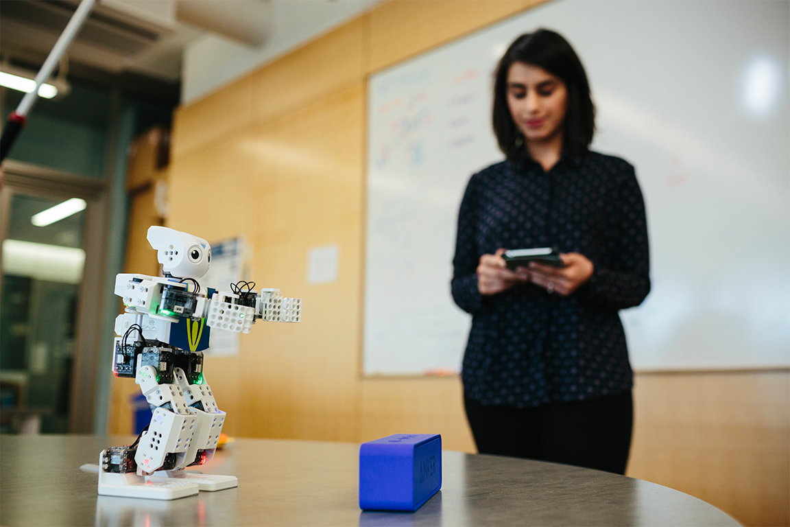 Student testing robot with programmed software