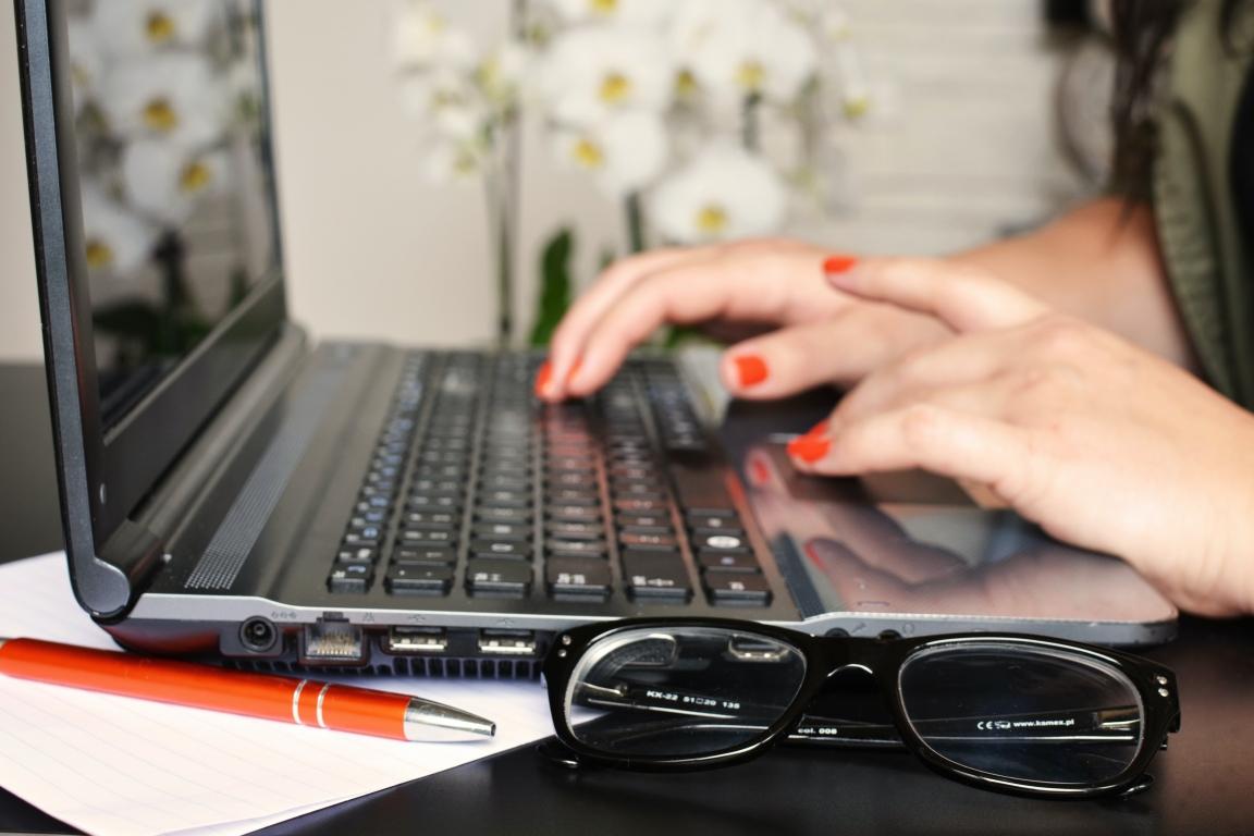 Finger on laptop keyboard